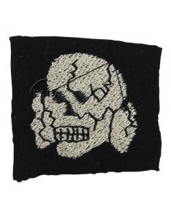 Skull, cloth, on wool
